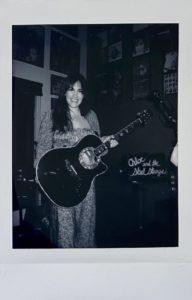 Chloe Polaroid with Guitar