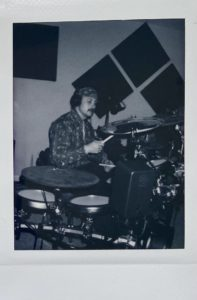 Cody on the drums polaroid
