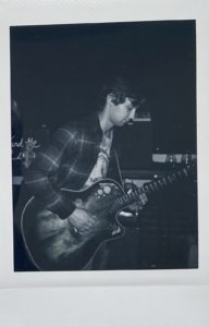 Eric on the guitar polaroid