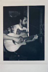 Connor with a guitar polaroid